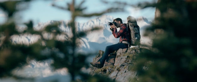 IMAGE: Still –Rack focus through trees, Mike on the edge of the cliff