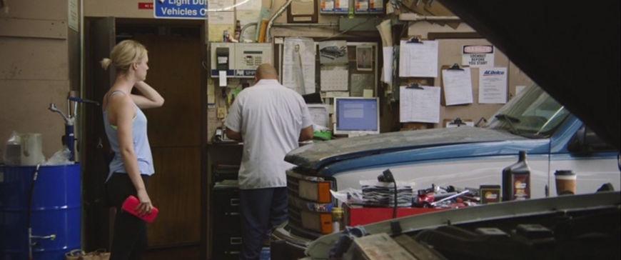 IMAGE: Still - Mackenzie Davis in garage with mechanic