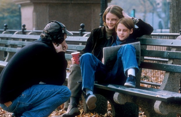 IMAGE: Fincher directing Jodie Foster and Kristen Stewart outside on bench